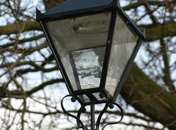 Circuit breakers were invented to protect street light bulbs from current surges.