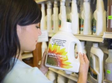 Woman looking at laundry detergent.