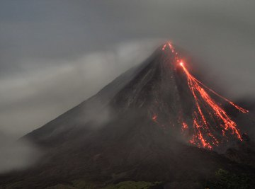 Example of a volcano with lava running down the side.