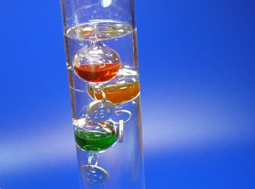 The small medallions attached to Galileo thermometer spheres are actually calibrated counterweights.