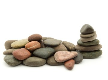 Identify the crystals in rocks by using a rock identification book or by searching the Internet