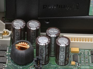 Electrolytic capacitors in a circuit board.