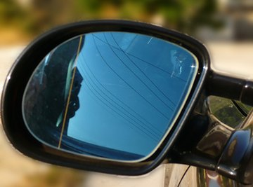 Mirrors are found on vehicles because they improve line of sight.
