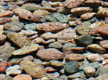 Customize the size and shape of river rocks in a rock tumbler.