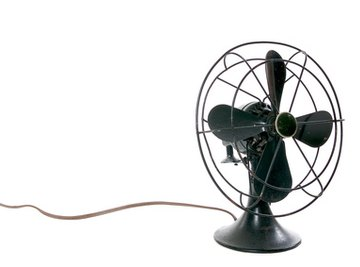 An electromagnet causes the fan blades to turn.