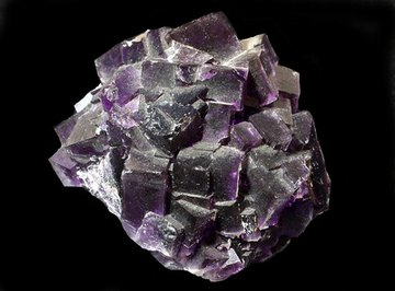 Fluorite is a mineral that commonly glows under UV light.