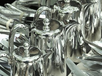 Silver coffeepots and flatware.