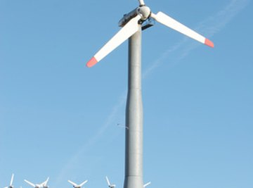 A wind turbine is a device that uses both electricity and magnets.