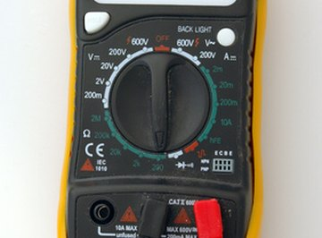 A digital multimeter provides an easy to read screen for testing a step-down transformer.