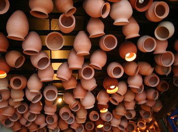 Make clay pots to filter water.