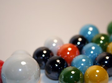 You can calculate the average mass of a marble by dividing the total mass by the number of marbles.