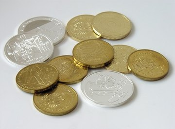 Coins that contain steel or iron can be picked up with a magnet.
