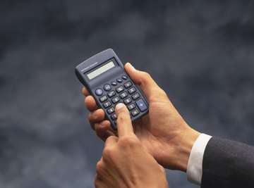A man is holding a calculator.