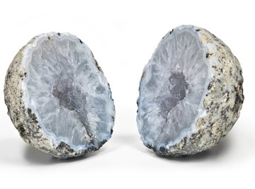 Correctly using the right settings on a iron pipe cutter will split the geode in two.