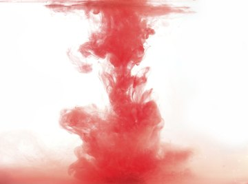 Red ink dropped into water.