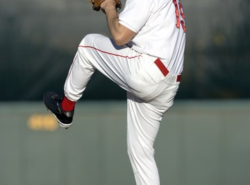 The pitcher's motion gives mechanical energy to the baseball, sending it toward home plate.