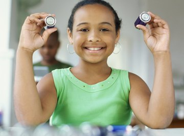 Batteries can discharge if a circuit connects the positive and negative ends.