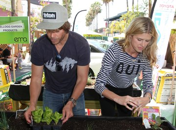 Two environmental activists promoting awareness at an event.