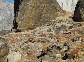Chemical weathering can leave rust-colored streaks and other discolorations on rocks.