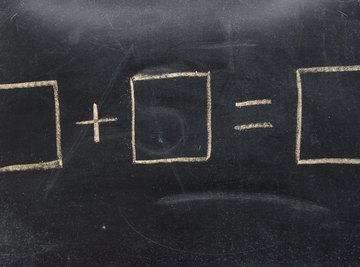 Close-up of equal sign equation on chalkboard.