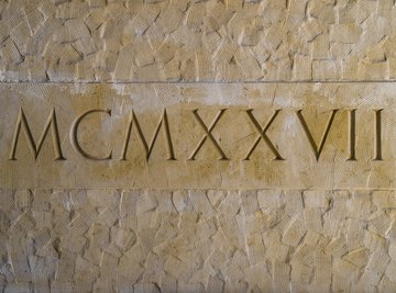 Roman numerals engraved in a stone wall.