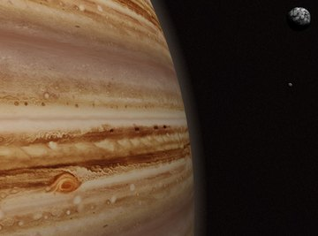 Jupiter gets its striking banded appearance from chemical clouds buffeted by wind currents.
