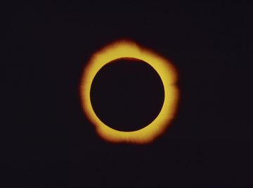 A total solar eclipse occurs when the moon completely blocks out the sun.