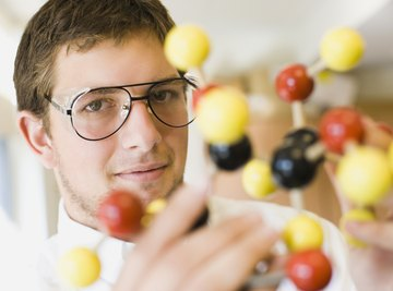 Student holding a molecular model