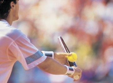 A man preparing to serve during a tennis match.