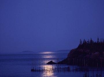 The moon's gravitational pull creates ocean tides.