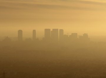 Photochemical smog forms in sunny, low-lying metropolitan areas subject to inversion layers.
