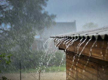 Rain water dripping off of a roof.