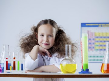 A little girls with her chemistry set.