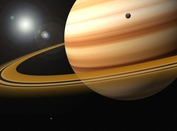 Saturn travels slowly in its orbit but spins quickly on its axis.