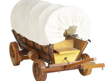 Covered wagons carried mostly provisions and sheltered pioneer families while they built houses.