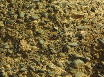 Wet soil has a density of 2,700 pounds per cubic yard.