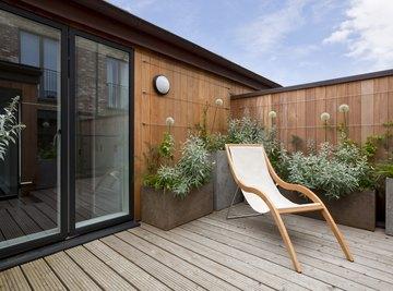 A sunning chair on an urban garden balcony.