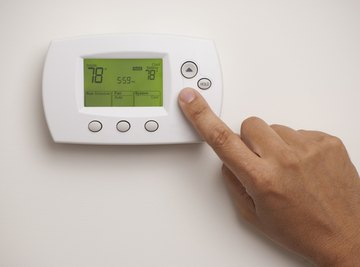A home thermostat includes a thermistor exposed to the room air.
