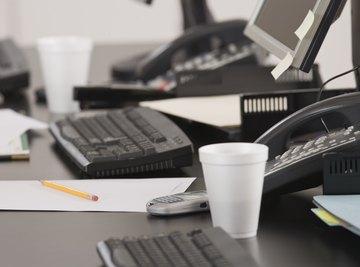 A styrofoam cup on an office desk.