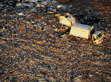 Trash compactors help landfills stay open as long as they can by filling each area with as much trash as possible.