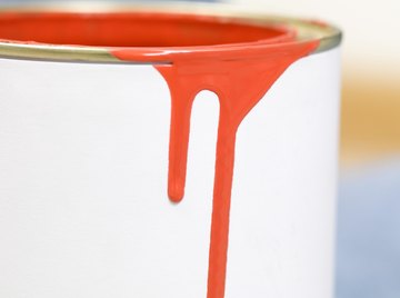 Painting your rain barrels a dark color helps prevent algae growth.