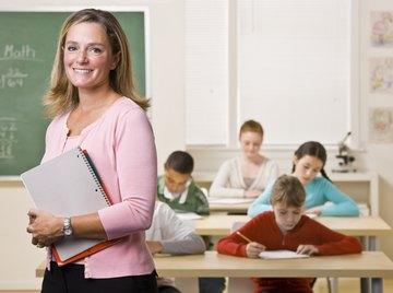A smiling math teacher in class.
