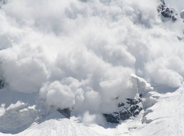 An avalanche coming down a mountain.