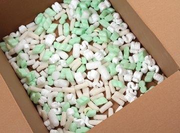 Opened cardboard box filled with polystyrene foam peanuts.