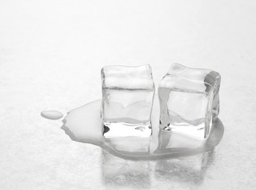 Ice cubes melting on table.