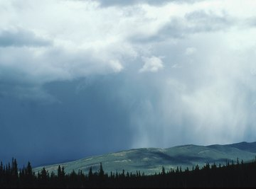 Rain shadows develop in areas shielded from prevailing winds by mountains.