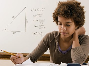 Young student studying geometry