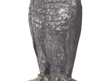 Owls, which prey upon other birds, will help to scare birds away.