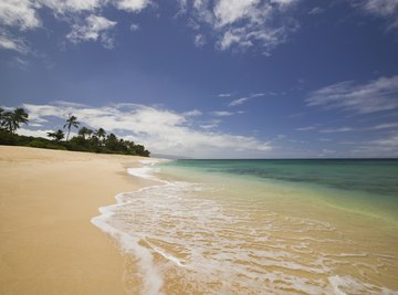 Beach sand is created by weathering and eroded by wind and waves.