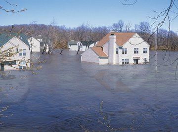 Floodwaters cause damage to homes.
